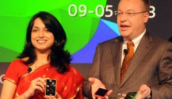 Chief Executive Officer (CEO) of Nokia Corporation Stephen Elop holds a Nokia Asha 501 as he addresses an unveiling ceremony in New Delhi